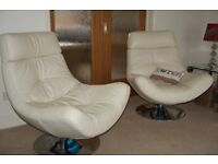 Swivel armchairs. Pair in white leather