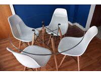 Designer round glass dinning table almost brand new to match iconic Eames chair