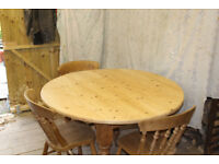 Round dining / kitchen table with four beech chairs