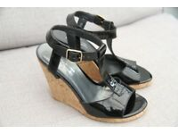 Ladies Russell and Bromley black patent wedge sandals. Size 5.