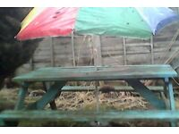 Garden picnic bench with parasol