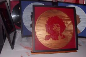 Artwork on vinyl records and canvas