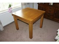 3 ft x 3 ft rustic oak dining table (extends 5ft)with 2 leather chairs