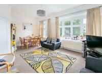 SPACIOUS three double bedroom flat with a garden.