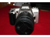 THE MINOLTA 404SI DYNAX 35MM FILM SLR CAMERA IN GREAT CONDITION