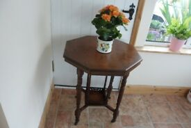 Lovely Antique Table with octaginal shaped top in walnut, I think. See photo attached.