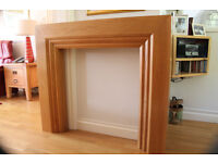 Solid light-oak fireplace surround, vgc. £50 Cost new £549. 9yrs old