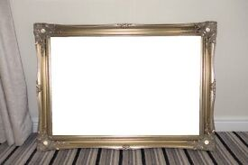 Gold framed mirror with bevelled glass