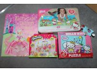 Girls toy bundle includes 4 hello kitty and 1 shopkins jigsaws and 1 craft book