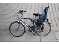"""Used 28"""" weel-bike with child seat, new bike saddle and front tyre."""