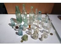 A selection of old and antique glass bottles in good condition.