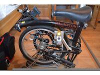 Folding Brompton bike with satchel