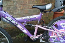 Girls Pink/Purple Townsend Axis Mountain bike suit a 5 to 10 year old approx, in good used condition