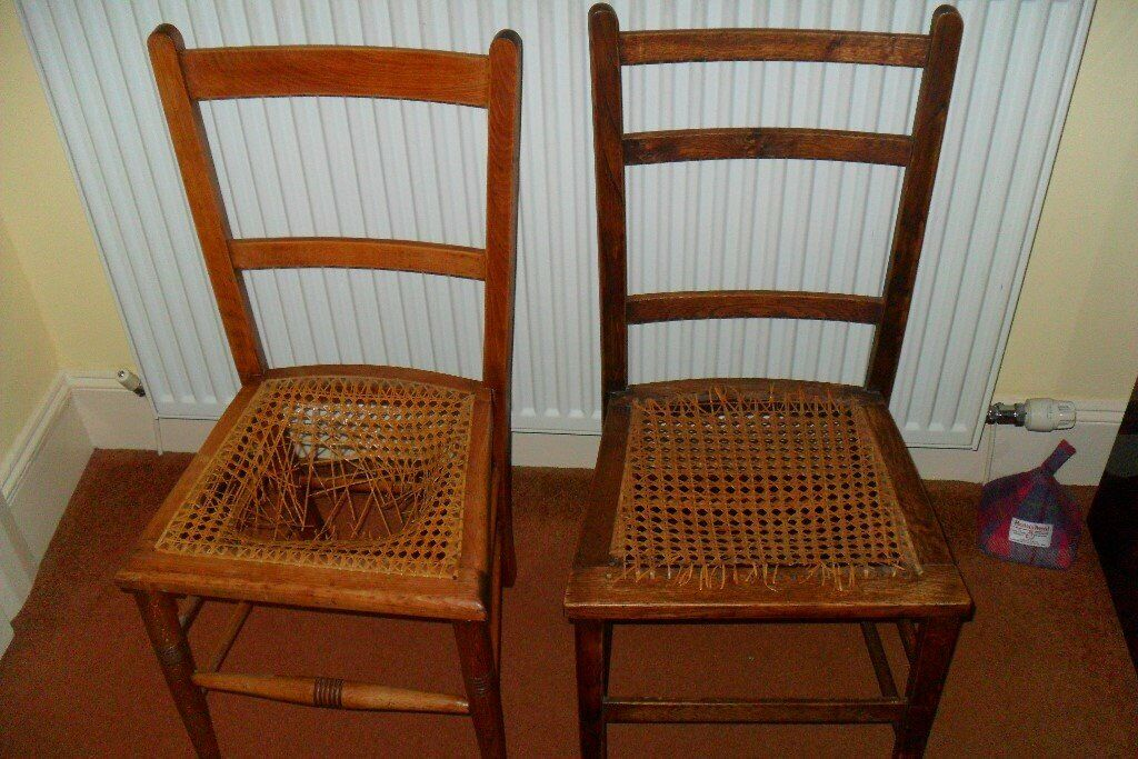 Two Small Wooden Chairs With Cane Seats Which Need Repairing In