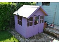 Wooden childrens playhouse/shed