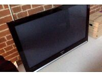 "Large TV 48"" x 31"" Samsung Plasma with floor stand."