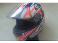 Lazer motorcycle helmet size XS but will fit a small comfortably