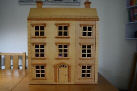 Dolls House with furniture and family