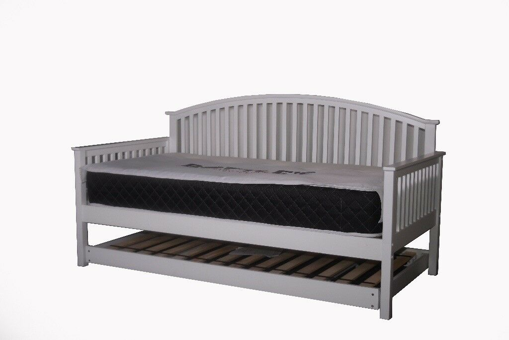 White wooden day bed