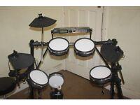 Alesis DM5 complete electronic drum kit as described below