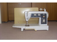 Singer 702/722 sewing machine with accessories as seen.