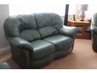 GREEN LEATHER SOFA AND TWO CHAIRS will separate