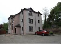 Attractive, two bedroom top floor flat close to all local amenities.