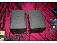 2 small black JVC speakers with cable