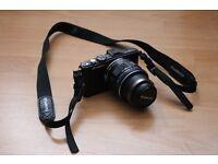 Olympus digital Pen lite E-pl5 Camera with a Olympus 14-42mm lens