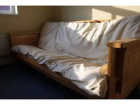 Wooden sofa bed with mattress