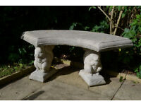 A demountable stone squirrel garden seat in three sections for transportation