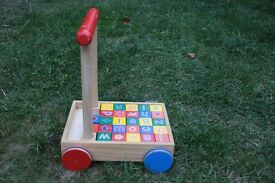 Wooden children's walker with wooden blocks