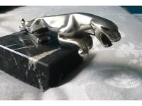 Leaping Jaguar from XJ6 mounted on black marble block