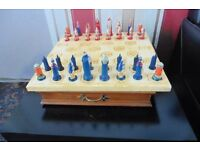Chess-set in wooden case & Chessbord.