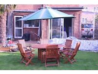 Garden table + 6 chairs + parasol + Parasol stand - recently varnished, kept under shelter