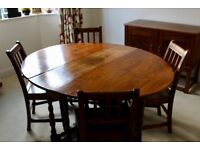 Antique Oak Dining Table with 4 chairs.