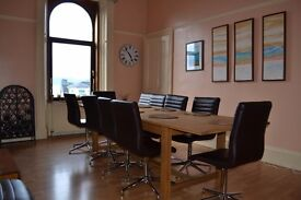 Laura Ashley 12 seater extending table with 12 faux leather chairs cost £2000 sell for £1000