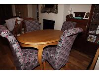 Oval Solid Oak Table with Queen Ann Legs and 4 fabric chairs.