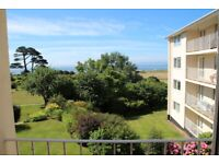 Room in beach-side flat with sea views & garage!