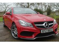 Mercedes E350 Coupe, beautiful in a bright red with lovely tan leather seats.