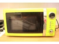 New microwave with no more than one month of use.