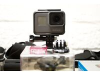 GoPro Hero 5 Black Edition Action Camera with dive filter and accessories, excellent condition.