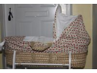 Green floral Moses Basket and white rocking stand