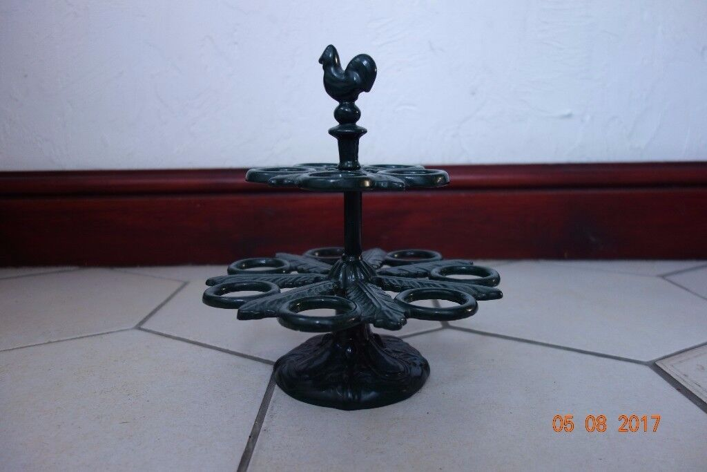 Cast Iron Egg Stand. Green leaf design. Holds up to 12 eggs