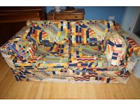 Sofa bed, well made but old, upholstery worn.