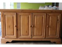 Light wood veneer sideboard with shelves and a drawer