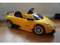 Yellow kids electric car Lamborghini