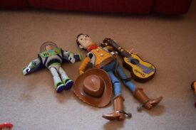 """8"""" talking Buzz Light year toy and 16"""" Sheriff Woody soft Toy with hat and guitar that makes sounds."""