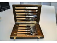 Silver fish knife and fork set in original wooden box