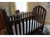 Large wooden cot with John Lewis mattress and sheets